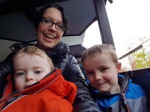 Mom with two boys smiling