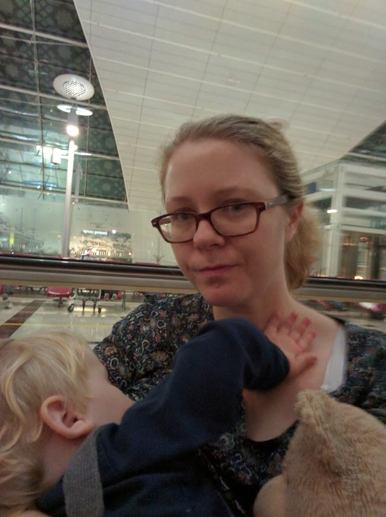 Mom on the airport breastfeeding her boy